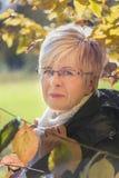 Sênior no outono Fotos de Stock Royalty Free