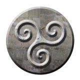 Símbolo céltico antiguo del triskele en piedra Fotos de archivo