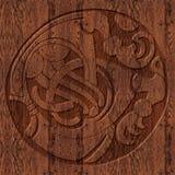 Símbolo céltico de madera tallado Imagen de archivo libre de regalías
