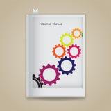 Símbolo colorido del engranaje con concepto industrial en la cubierta de libro en blanco Foto de archivo