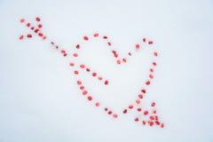 Símbolo Corazón en la nieve Foto de archivo libre de regalías