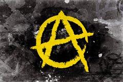 Símbolo da anarquia em um fundo Fotos de Stock