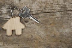Símbolo da casa com chave de prata imagem de stock