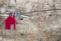 Símbolo da casa com chave de prata imagens de stock