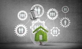 Símbolo da casa dentro da ampola de vidro Imagem de Stock Royalty Free