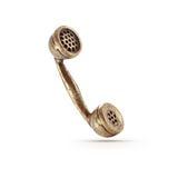 Símbolo de bronce del teléfono Imágenes de archivo libres de regalías