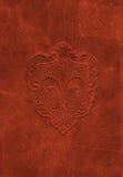 Símbolo de cuero de la flor de lis de la vendimia imagenes de archivo