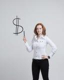 Símbolo de dibujo del dólar de la mujer joven Foto de archivo