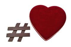 Símbolo de Hashtag del chocolate con la caja en forma de corazón Fotos de archivo
