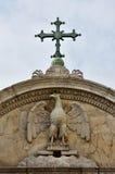 Símbolo de John Evangelist del santo con la cruz en Venecia foto de archivo libre de regalías