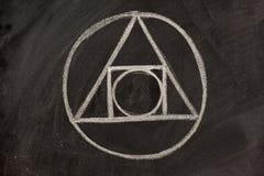 Símbolo de la alquimia en una pizarra Imagenes de archivo