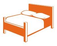 Símbolo de la cama Imagen de archivo