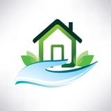 Símbolo de la casa en la palma Imagen de archivo libre de regalías