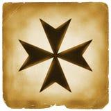 Símbolo de la cruz maltesa en el papel viejo imágenes de archivo libres de regalías