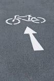 Símbolo de la flecha del carril de la bici de la bicicleta Imagenes de archivo