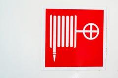 Símbolo de la manguera de bomberos Foto de archivo libre de regalías