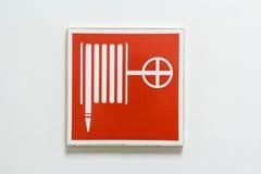 Símbolo de la manguera de bomberos Imagenes de archivo