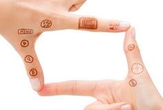 Símbolo de la mano que significa la cámara digital Fotografía de archivo libre de regalías