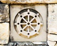 Símbolo de la rueda del budismo Imágenes de archivo libres de regalías