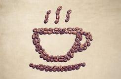 Símbolo de la taza de café hecho fuera de los granos de café Imágenes de archivo libres de regalías