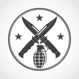 Símbolo de los cuchillos y de la granada de Crosed Fotografía de archivo libre de regalías