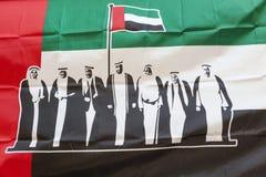 Símbolo de los United Arab Emirates en el fondo de la bandera de los UAE Imagenes de archivo