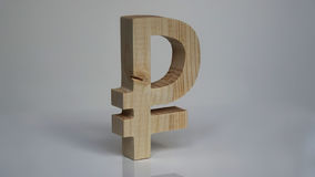 Símbolo de madeira do rublo de russo em um fundo branco Fotografia de Stock Royalty Free