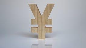 Símbolo de madeira dos ienes em um fundo branco Imagens de Stock