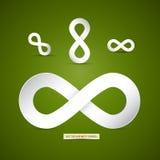 Símbolo de papel del infinito en fondo verde Imagen de archivo libre de regalías