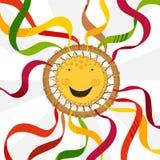 Símbolo de Shrovetide decorado com fitas Roda-Sun com uma cara do sorriso Foto de Stock