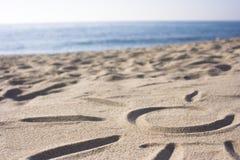 Símbolo de Sun na areia Imagens de Stock