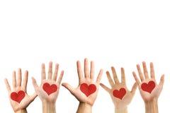 Símbolo del amor en la palma de la mano Foto de archivo libre de regalías