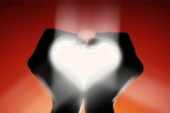 Símbolo del amor que brilla intensamente Foto de archivo