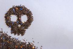 Símbolo del cráneo del té matanzas pobres del té Fotografía de archivo