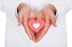Símbolo del doctor Holding Heart Shape Imagenes de archivo