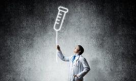 Símbolo del doctor y del frasco fotos de archivo