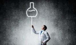 Símbolo del doctor y del frasco foto de archivo libre de regalías