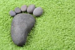 Símbolo del pie en la toalla de Terry Imagen de archivo libre de regalías