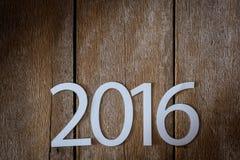 Símbolo del suspiro del número 2016 en el viejo estilo retro t de madera del vintage Fotos de archivo