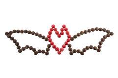 Símbolo Dia das Bruxas - um bastão fora dos doces redondos isolados Fotografia de Stock Royalty Free
