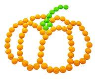 Símbolo Dia das Bruxas - uma abóbora Composto de doces redondos pequenos foto de stock royalty free