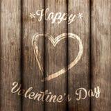Símbolo do amor na parede de madeira velha Imagem de Stock