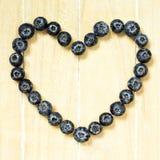 Símbolo do coração feito com mirtilos frescos Fotografia de Stock Royalty Free