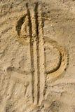 Símbolo do dólar na areia Fotografia de Stock Royalty Free