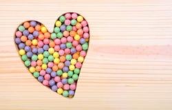 Símbolo dos doces e do coração do Valentim Foto de Stock