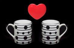 Símbolo e copos do coração Fotos de Stock