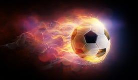 Símbolo inflamado de la bola del fútbol fotografía de archivo libre de regalías