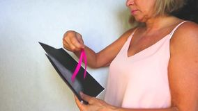 Símbolo internacional del mes de la conciencia del cáncer de pecho en octubre espacio rosado de la copia de la conciencia de la c metrajes