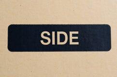 Símbolo lateral preto na caixa Imagens de Stock