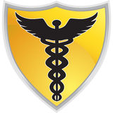 Símbolo médico del caduceo con el blindaje Imagen de archivo
